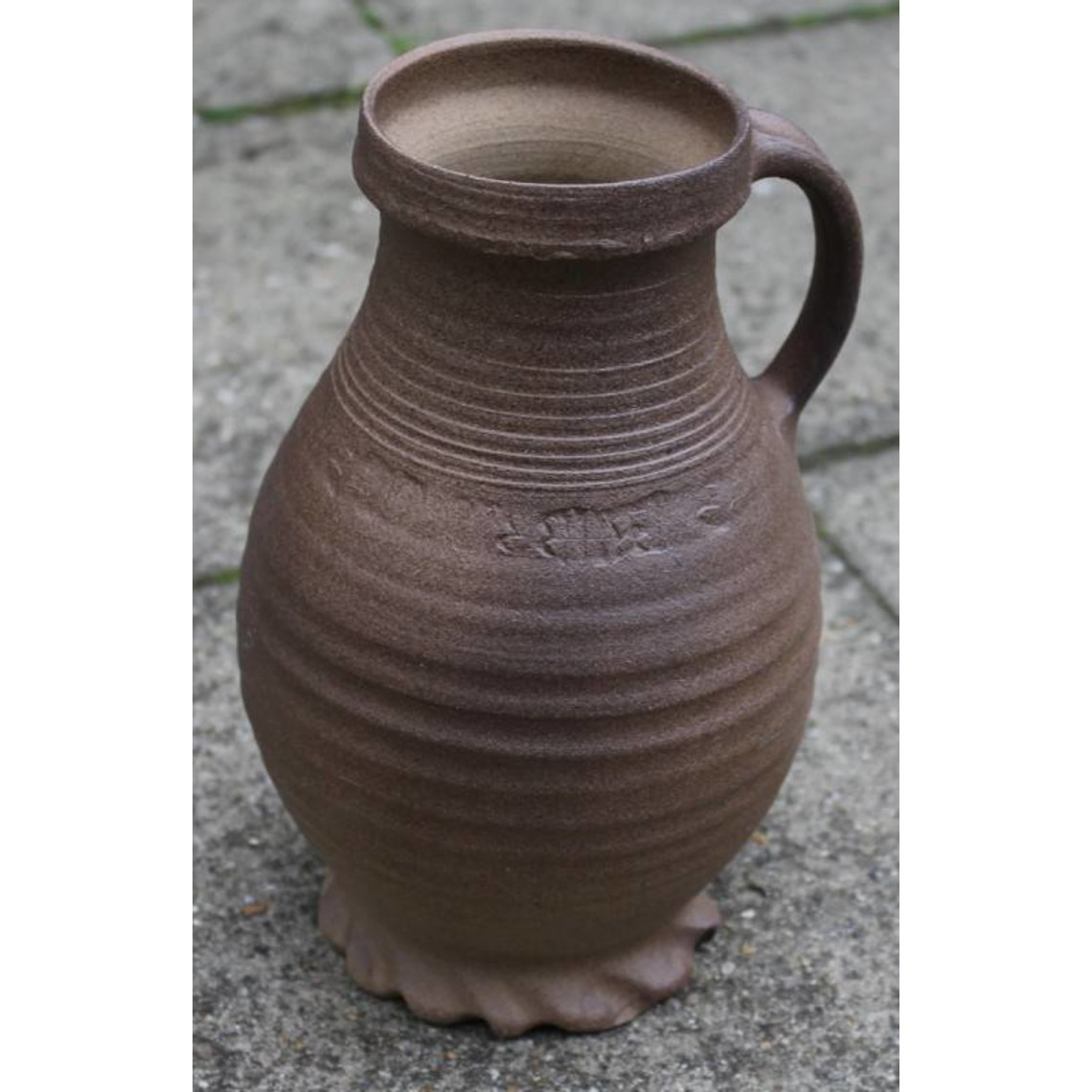13th century jug with imprints