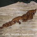 Dragón vikingo de madera mirando a la derecha