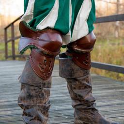 Par av läder poleyns, brungröna
