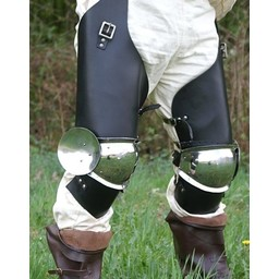 Une paire de bottes au genou avec des morceaux de cuir