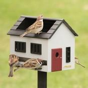 Grijs vogelvoederhuis met vogelbadje