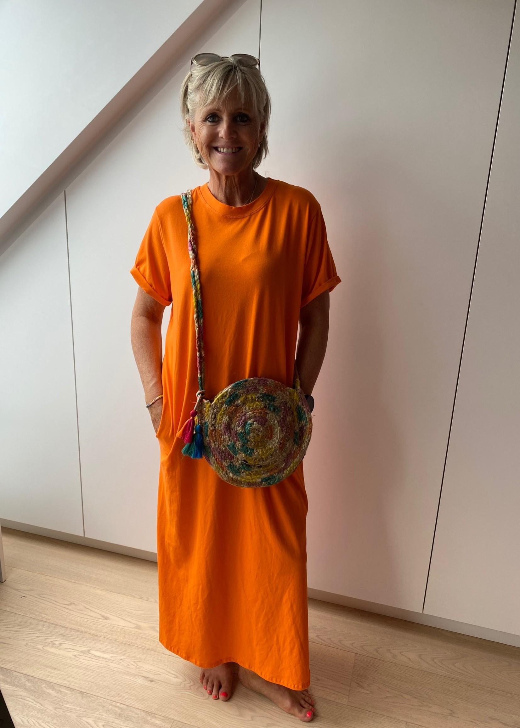 Love Lang kleed met zakken in het oranje