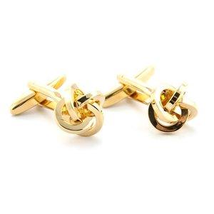 Manchetknopen goudkleurige knoop
