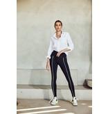 deblon sports Deblon Sports Kate trägt Sportgamaschen mit Neon-Nähten in Schwarz