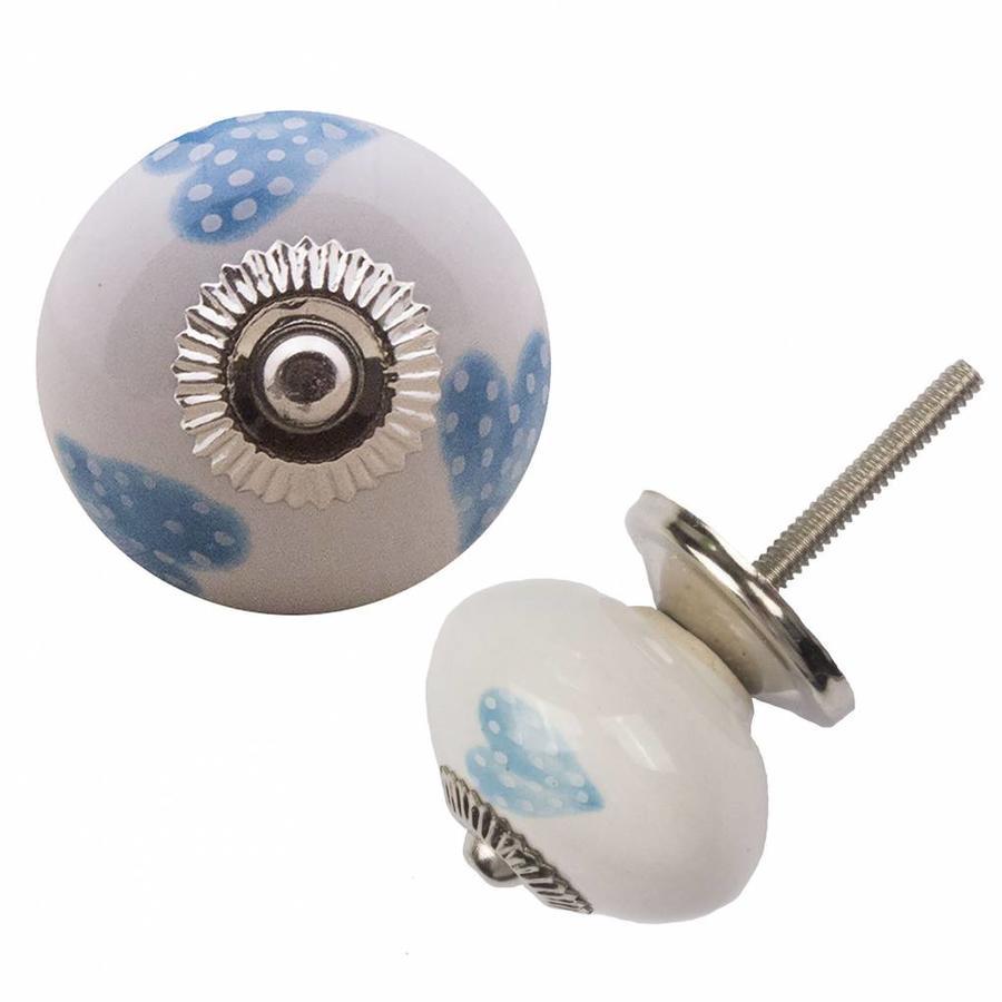 Porseleinen meubelknop wit blauw gestippelde hartjes - licht