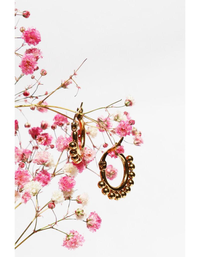 Golden earrings with balls