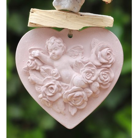 Geparfumeerd engeltje in de geur rozen