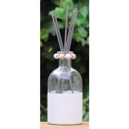 Wit vaasje voor geurstokjes