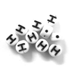 Cuenta DQ H. Letter alfabet kraal glas wit met zwarte opdruk 5x6mm
