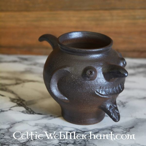 13th century cup with face