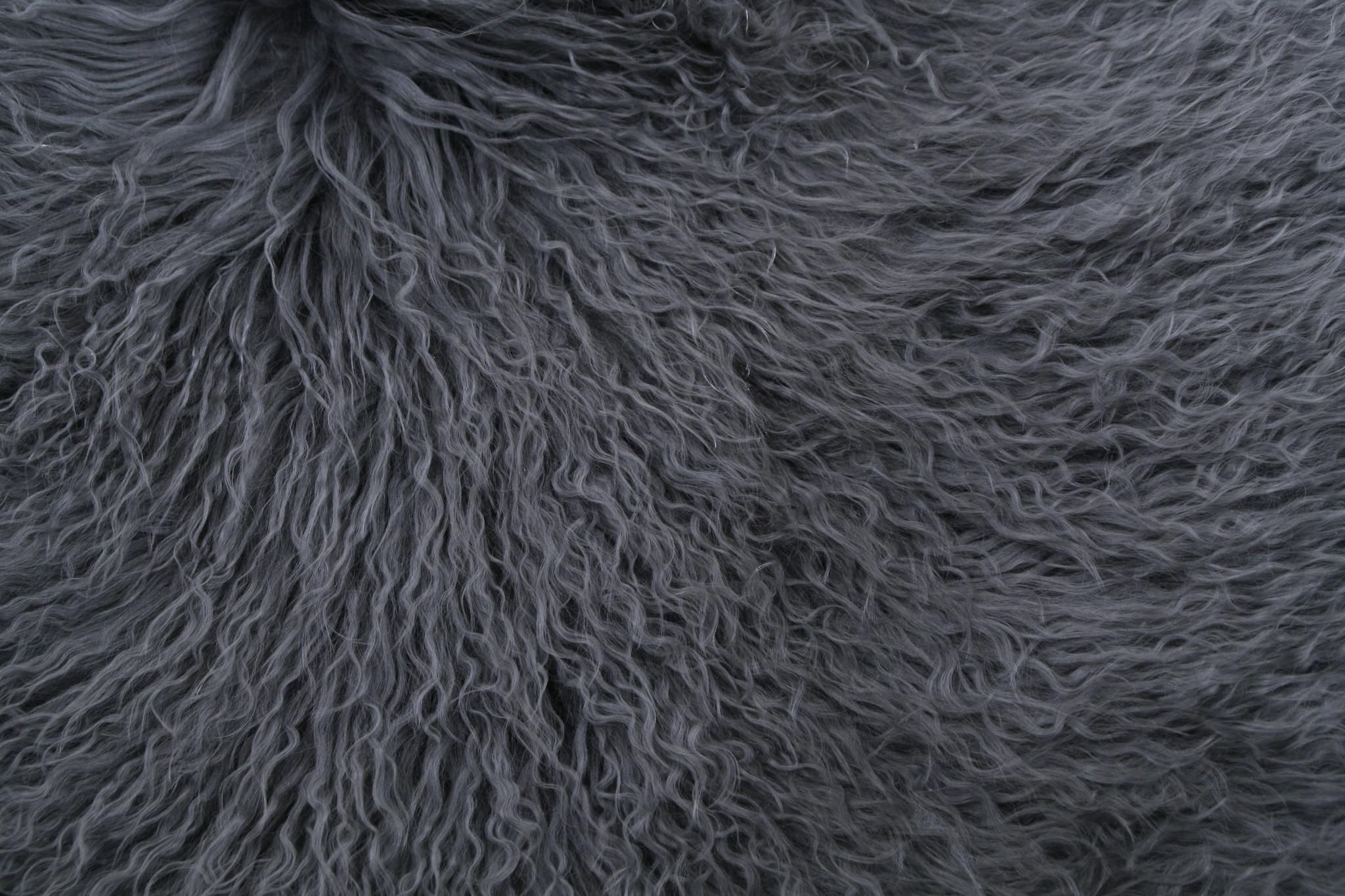 testVan Buren Schapenvacht petrol Tibetaans met gekrulde lange haren