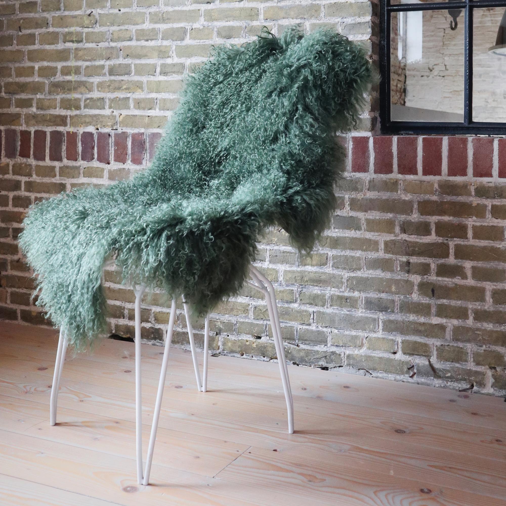 testVan Buren Schapenvacht gras groen Tibetaans met gekrulde lange haren