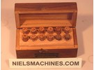 Sold: Assortment of bronze bushings and ruby jewels
