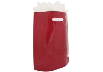 Plastic draagtas met gestanste handgreep bord
