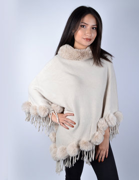 Poncho with faux fur