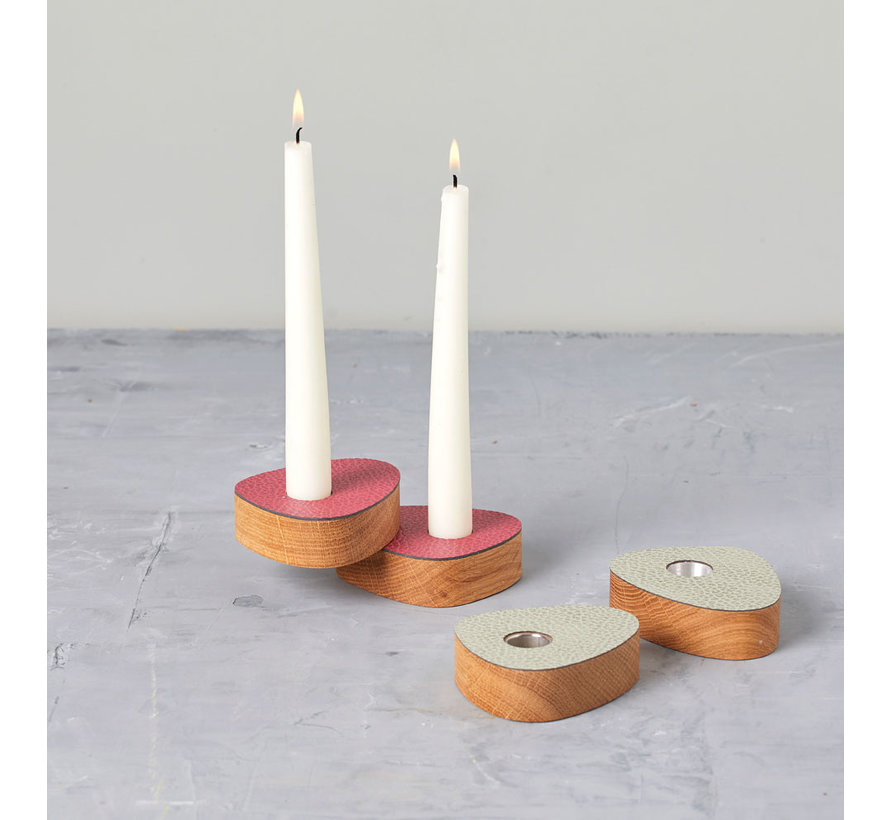 two magnetic candlesticks in oak with raspberry red leather