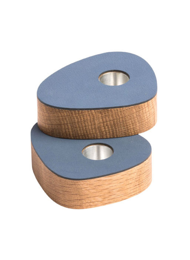two magnetic candlesticks in oak with dark blue leather
