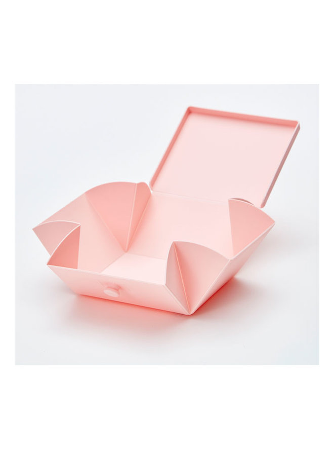 pink folding lunch box that you can also use as a plate. With white strap.