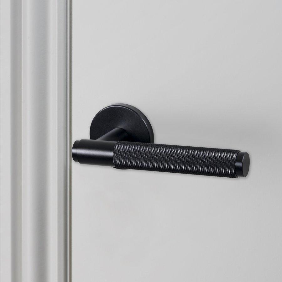 Zwarte deurklinken van Buster & Punch met 'cross' geslepen handvat