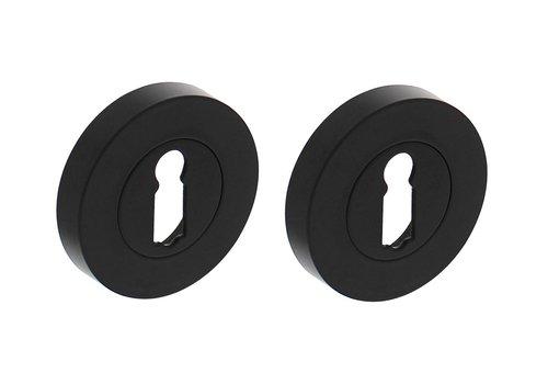 Paar sleutelplaatjes rond zwart