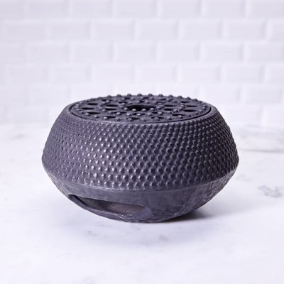 Cast iron teapot warmer