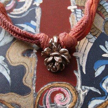 """Catherine Michiels """"La Pivoine"""", Bronze, silk cord"""
