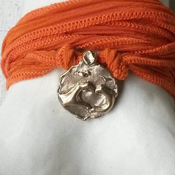 """Catherine Michiels """"Amour Toujours"""", Bronze, silk cord"""