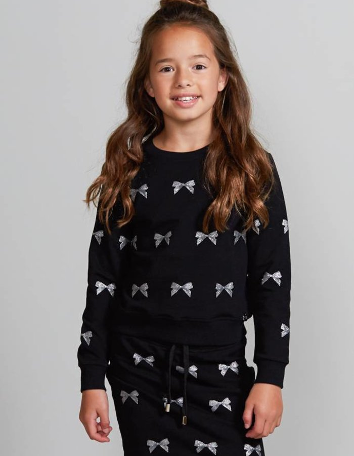 Sweater met metallic strikjes