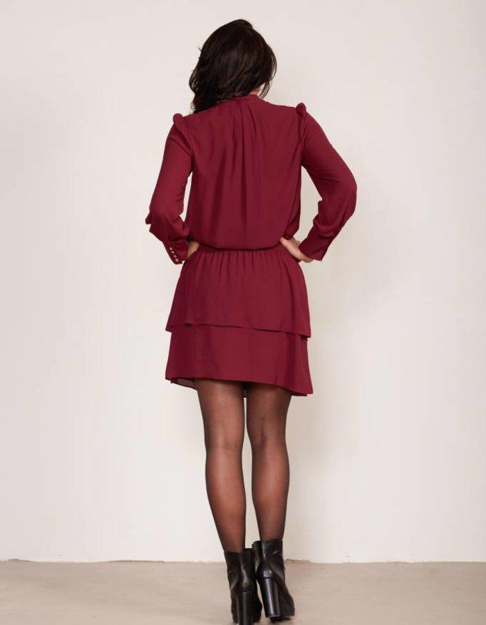 Gelaagde jurk met strikdetail