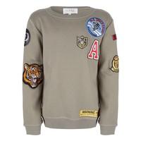 Sweater met badges