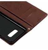 Klavertje Bloemen Booktype voor Samsung Galaxy S10e - Bruin
