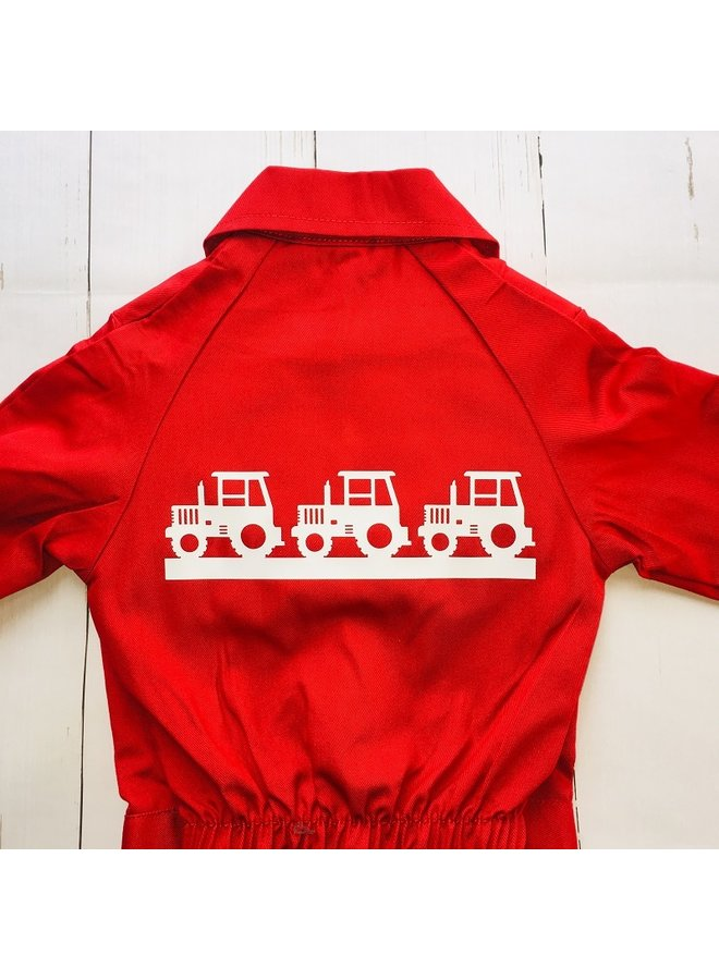 Children's overall with a border of tractors