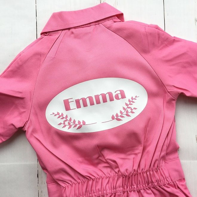 Children's overall printed with an emblem with twigs and name
