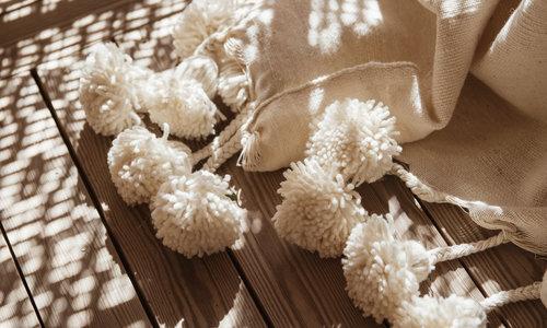 Handwoven pompom blankets