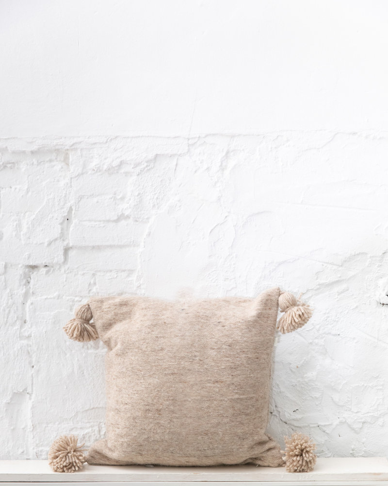 Handwoven pom pom pillow M
