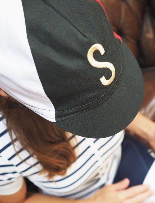 Classic four-panel multi-coloured cap
