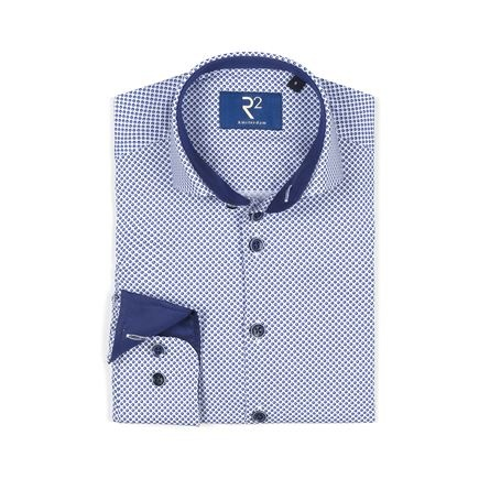 R2 Kids wit shirt with blue dots all over.
