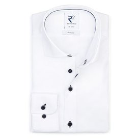 White non iron shirt with blue buttons.
