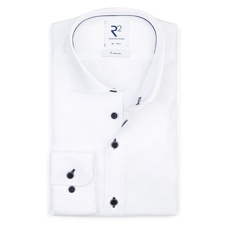 This white non iron shirt with blue buttons is perfect for travelling or if you don't prefer ironing.