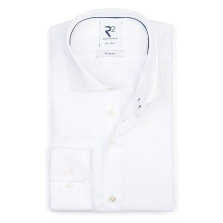 Wit strijkvrij overhemd.