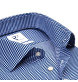 This blue non iron shirt has a pied de poule weave and is perfect for travelling or if you don't prefer ironing.