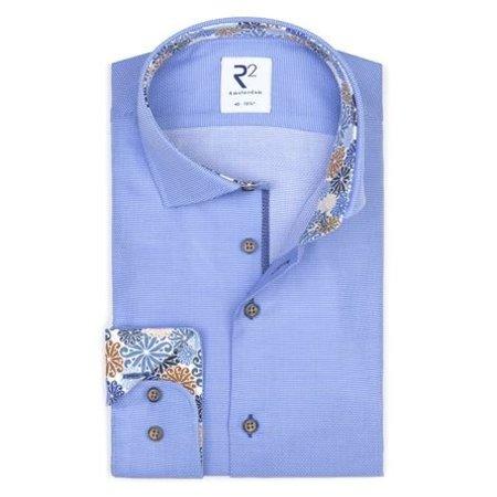 Light blue plain cotton shirt.