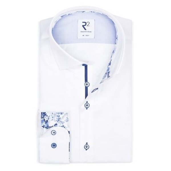 Contrast with blue flower print. Tape on the button placket.