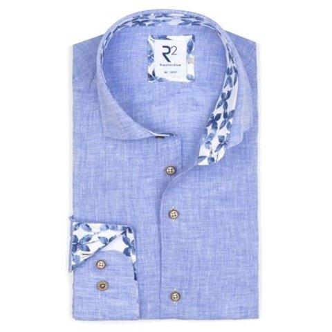 Light blue plain linen shirt.
