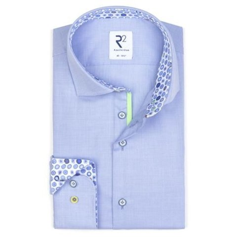 Light blue shirt.