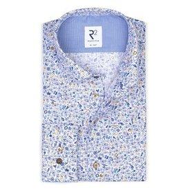 White cotton shirt with blue bike print.