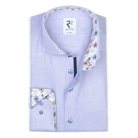 Blue oxford cotton shirt.