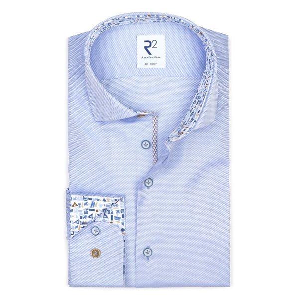 Lichtblauw dobby katoenen overhemd.