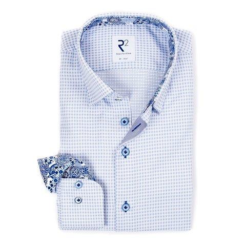 Hellblau kariertes Mini-Baumwollhemd mit Brusttasche.