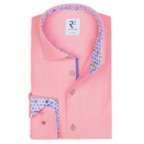Neon pink cotton shirt.